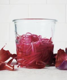 Macerated Red Onion Recipe1 medium red onion, thinly sliced (2 cups) 1/4 cup red wine vinegar kosher salt  Combine the onion, vinegar, and 1 teaspoon salt in a large jar and shake to combine. Let sit until the onion is bright red and slightly softened, 30 to 45 minutes. Refrigerate for up to 1 week.