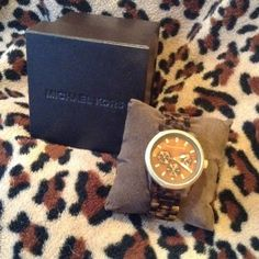 Michael Kors watch tortoise color Brown and gold MK watch in like new condition. Box included. Michael Kors Jewelry