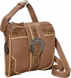 Organizer cross-body with adjustable shoulder strap, contains a handbag and a wallet in one. Two main zipper compartments, back zipper compartment, and fold-open wallet between the 2 main compartments. Body is made of soft brown distressed man-made chrome leather, and trimmed in embossed floral materials. Trimmed with gold accents, and features a bold silver buckle. Bold bandana print cotton lining. Includes a signature Bandana paisley keepsake.