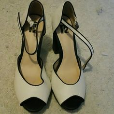 Ankle strap heels Black and cream heels. Never worn. Come with box. Offers encouraged! r2 Shoes Heels