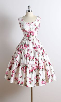 ➳ vintage 1950s dress * white cotton * gorgeous pink floral print * bow accent * metal side zipper * by Wendy Wood condition | excellent fits like small length 45 bodice 17 bust 36-38 waist 26-27 hem allowance 1.75 ➳ shop http://www.etsy.com/shop/millstreetvintage?ref=si_shop ➳ shop policies http://www.etsy.com/shop/millstreetvintage/policy twitter | MillStVintage facebook | millstreetvintage instagram | millstreetvintage 5742/1618