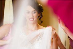 Bride prepares to put on her veil