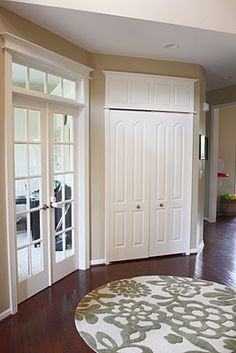 Add character to your doors and windows -  Moldings were installed above each door to create the illusion that the doors are the same height!