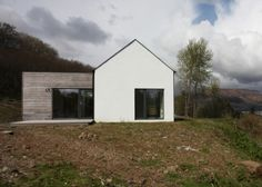 Like the combination of the white render and the larch cladding. Also like the clean simple lines.