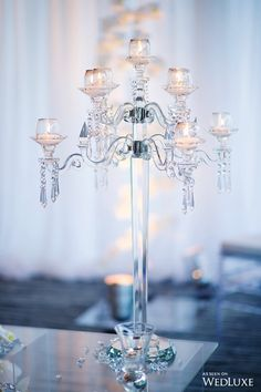 This Crystal Candelabra is Romantic and Glamourous. Perfect For Any Decor! | Photography By: Hong Photography and Cinema Inc. | WedLuxe Magazine | #wedding #weddinginspiration #luxury #eventdecor #centerpiece #crystal #weddingceremony #romantic