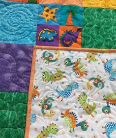 Dinosaur Baby Quilt with dinosaur flannel backing from http://www.HomeSewnByCarolyn.com