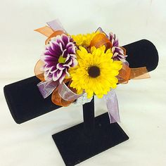 Wrist corsage of purple daisies & yellow Viking mums.