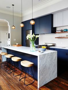 A bonus to love a color, blue, that is also trending..a block of color is also easy to change...The Classic Kitchen Color Trend That's Instagram-Approved via @MyDomaine