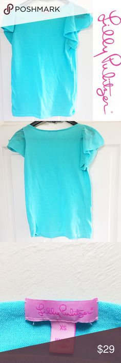 Lilly Pulitzer Light Blue Flutter Cap Sleeve Top Lilly Pulitzer Light Blue Aqua Cotton Flutter Ruffle Cap Sleeve Top Shirt Size Extra Small 100% cotton Small light stain on top front right of blouse, see pictures  Preowned good condition Lilly Pulitzer Tops Blouses