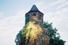 a high tower, brown, blue, green