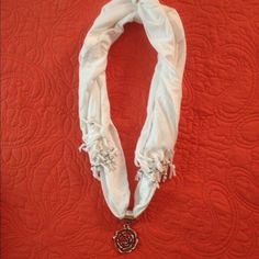 Scarf New, handmade with silver beads at the ends with large flower silver pendant in the middle SMOKE FREE AND PET FREE HOMEOffers are welcome Jackets & Coats