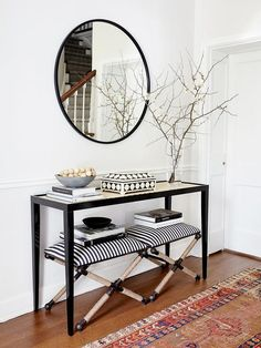 Uttermost Braddock Small Bench features a black and white pattern with rope x legs under an Oomph Jerome Console Table.