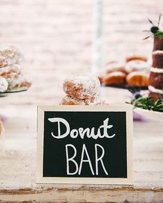 Who says wedding cake has to be the only sweet you serve? Include donuts in your dessert bar, or go (do)nuts—we had to—with a table teeming with the treats.