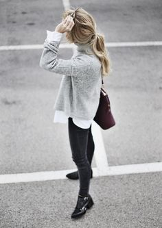 A simple white shirt underneath a grey slightly oversized sweater paired a pair of black skinny jeans can be easy way to achieve the tomboy look. Photography Via Mary Seng