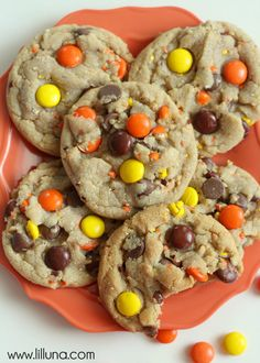 Soft and delicious Reeses Pieces Chocolate Chip Cookies on { lilluna.com } Melt in your mouth cookies full of chocolate chips and crushed reeses with whole reeses on top!