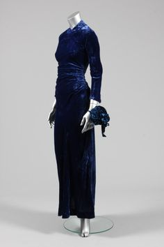 Maggy Rouff couture sapphire-blue crushed velvet evening gown, circa 1930, cut on the bias with ruching to the hips which creates gentle drapes at the front and back, small buttons and loops to the lower back to fasten