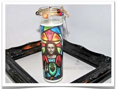 Sacred Heart of Jesus Candle by theRDBcollection, $24.00 | Photo by Renee Dent Blankenship | A vibrant photo candle of a stained glass window with jute and beads tied round the neck | More candles can be found at therdbcollection.etsy.com