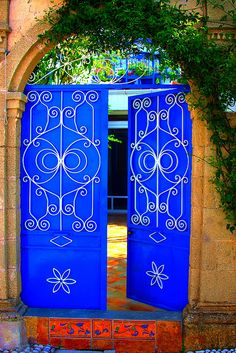 Cobalt blue door with ironwork