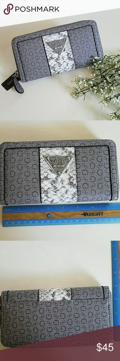 Guess Wallet Beautiful brand new with tag 100% authentic Guess Wallet. Leather. See pics for size and pocket details. No stains or damages. Grey. Guess Bags