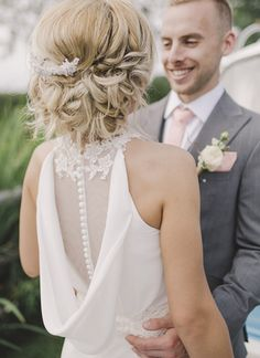 We LOVE the back of this gorgeous Cabotine wedding dress! A rustic and romantic summer scheme of peach and yellow featured bright and beautiful sunflowers for in the bride's bouquet alongside peach bridesmaids for this couple's summer rustic wedding - why not be inspired by their pretty ideas?