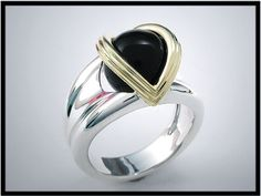 Petite Classic V Sterling Silver Orbis Ring with 18k yellow V.  Displayed with black onys sphere