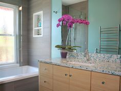 A great guest bath with simplicity and flare all in one. #FloatingBlue #Vetrazzo