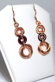 Chainmaille Earrings- Synthesis- Chainmaille with glass- Copper/Garnet. $15.00, via Etsy.
