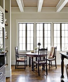 Designer Mary Jo Bochner placed an antique table and chairs sit in front of this Savannah, GA home's old casement windows, with wavy glass.   - HouseBeautiful.com