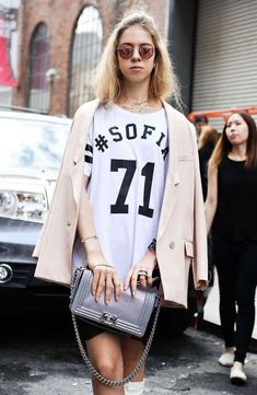 A delicate tan blazer (and Chanel bag, for that matter) gives a jersey a ladylike twist.