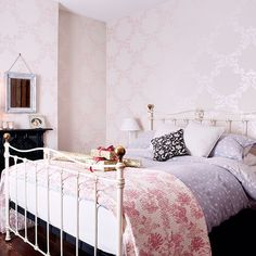 Pale pink wallpaper in this country style bedroom