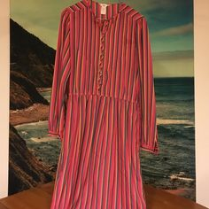 """VINTAGE colorful striped long sleeved shift dress What a cool dress! Picked it up at a vintage store last year. Extremely lightweight, multicolored stripes, buttons halfway down the front and at the sleeve cuffs. Tag has faded so I can't get fabric info, but under the brand """"Jack Mulqueen"""" it reads """"silksational"""". By feeling the fabric, it could possibly be silk. I would say it fits like a medium because there's no stretch in the fabric, and busty girls like me might have issues keeping the…"""