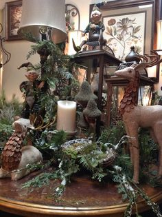 Burlap deer at Something Special. Love this floral arrangement for winter decorating. That whole winter woodland look.