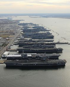NORFOLK (Dec. 20, 2012) The aircraft carriers USS Dwight D. Eisenhower (CVN 69), USS George H.W. Bush (CVN 77), USS Enterprise (CVN 65), USS Harry S. Truman (CVN 75), and USS Abraham Lincoln (CVN 72) are in port at Naval Station Norfolk, Va., the world's largest naval station.