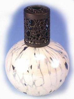 """WHITE with BLACK DOTS Fragrance Lamp by La Tee Da by WHITE with BLACK DOTS Fragrance Lamp by La Tee Da. $35.95. WHITE with BLACK DOTS Fragrance Lamp by La Tee Da Handmade Fragrance Lamp About 6"""" tall Regular Size Wick Included Snuffer Cap Included Heavy Metal Decorative Shade Included Funnel Included"""