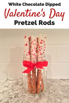 White Chocolate Dipped Valentine's Day Pretzel Rod Recipe -  This is an easy-peasy recipe for a sweet and salty treat that is perfect for a last-minute Valentine's Day treat.