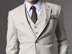 elegant summer suit: linen 3-piece suit paired with periwinkle blue shirt and burgundy tie