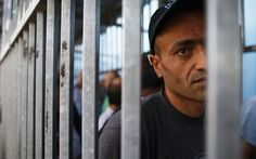 A Palestinian waits to cross into Jerusalem at an Israeli checkpoint in the West Bank town of Bethlehem June 23, 2013. REUTERS/Ammar Awad