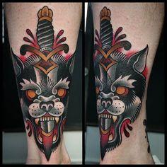 18 Dynamic Wolf Dagger Tattoos | Tattoodo.com