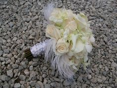 Ivory Bridal Bouquet with Roses, Orchids, Mini Calla Lilies and Feathers.