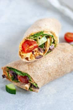 This Vegan Greek Salad Wrap is so simple yet packed with flavor. Hummus cucumber tomato pepperoncini kalamata olives and fresh spinach make for a delicious work or vegan school lunch. Vegan Dinner Recipes, Vegan Dinners, Lunch Recipes, Vegetarian Recipes, Vegetarian Wraps, Going Vegetarian, Vegetarian Breakfast, Vegetarian Cooking, Vegan Snacks