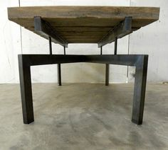 Gooseneck Coffee Table by Petrified Design In the Gooseneck coffee table's past life the material was used as the platform for an old gooseneck trailer. The natural age of the oak is brought out by the tones of the steel legs. Dimensions: Height - 19'' Width - 52'' Depth - 22'''