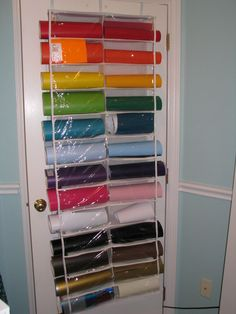 Love this idea for deco mesh or gift wrap rolls