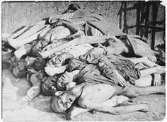 """""""Corpses piled up behind the crematorium in Buchenwald concentration camp, April 1945"""""""