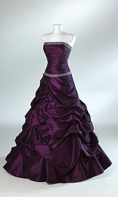 Strapless ball gown with pick-up skirt with jeweled detail and waist and neckline.