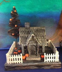 Spiky Shingled House from Tim Holtz' Village Dwelling die. More on my blog - withglueandglitter.blogspotcom