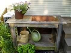 Potting Table/Bench with built-in cast iron sink from 1920's home.  Also, built and framed out with reclaimed wood planks from home.