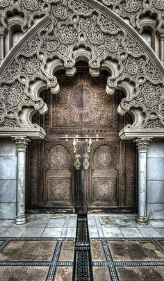 Exterior can be in total contrast to inside (idea). Photograph The Door to Doom by Harezad Abu