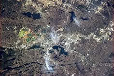 Sudbury, Ontario, rich in nichel and copper the ore put there by an asteroid 2 billion years ago.