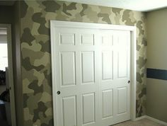 Awesome.  The black stripe on the wall is chalkboard paint.  <3 Camo accent wall!