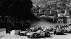 1955, XIII Grand Prix Automobile de Monaco. Monaco. Fangio and Moss (Mercedes w196) side by side at Gazometre cotner at first lap- -Photo by Bernard Cahier/ property Cahier Archive